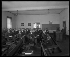 Professor and students in class in Alumni Hall