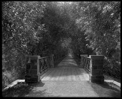 View down Willow Path with stone and iron bridge