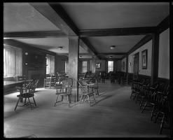 Social room in West Hall with chairs and fireplace