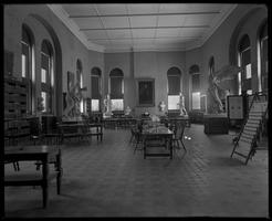 James B. Colgate Library reading room with plaster casts and hanging newspapers